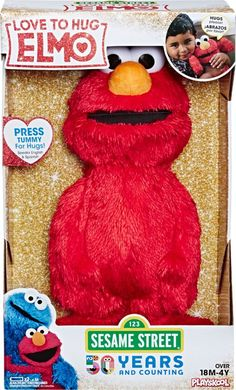 Give your child quality cuddle time with this Sesame Street Love to Hug Elmo plush toy. He raises his arms when his tummy is squeezed and gives big hugs, and he sings in English and Spanish for bilingual playtime. When hugged, this Sesame Street Love to Hug Elmo plush toy sings songs, offers a kiss and speaks cute phrases.
