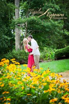 Engagement photo with beautiful spring color by Timeless Exposures Photography at The Oaks Events