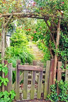 Photo about Rustic garden gate with vines and vegetation, leading to a garden path. Image of flora, gate, garden - 27259312 Garden Doors, Garden Gates, Old Gates, Unique Garden, Cedar Garden, The Secret Garden, Garden Cottage, Rustic Gardens, The Ranch