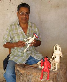 Mexican Day of the Dead Artist Inocensio Vasquez carving wood in Oaxaca, Mexico