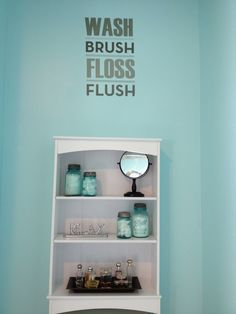Blue and brown bathroom. Love using my old blue mason jars. It goes so nicely with the colors.