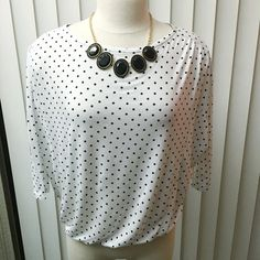 """Ann Taylor LOFT Polka Dot Top Ann Taylor LOFT Polka Dot Top with batwing sleeves. This top is perfect to wear with a pencil skirt, slacks, or even jeans! Polka dots never go out of style  Loose fit, bottom closure at the neck, pin tucked shoulders, 3/4 length sleeves and a banded bottom. Women's size XS (fits like a small). Neck to hem measures 19"""" when worn. Shoulder to shoulder measures 17.5"""". LOFT Tops Blouses"""