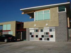 A beautiful modern garage door by bp Glass Garage Doors - http://www.glassgaragedoors.com/modern-garage-doors/