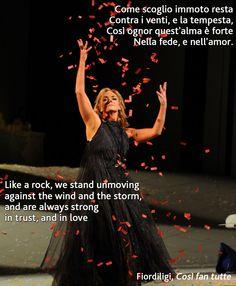 """Opera libretto from Cosi fan tutte. """"Like a rock, we stand unmoving"""". Photo is Sharon Prero as Fiordiligi, Opera Australia 2012."""