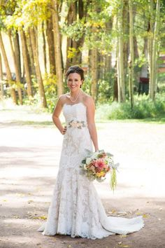 Bride Jenna wearing an Anne Barge wedding gown from Little White Dress Bridal Shop in Denver, CO at her Aspen wedding