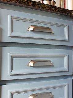 A Modern, Coastal Kitchen Remodel (On a Budget): Cup-style drawer pulls in the same polished nickel finish as the nautical knobs were added to the kitchen's drawers as well as the lower cabinet doors. Budget Kitchen Remodel, Kitchen Cabinet Remodel, Kitchen On A Budget, Kitchen Redo, Diy On A Budget, Kitchen Cabinets, Kitchen Ideas, Remodel Bathroom, Granite Kitchen