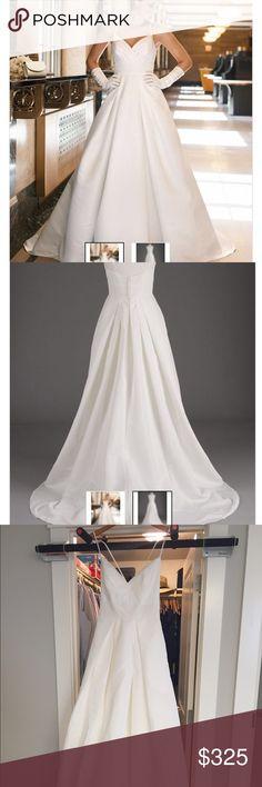 Unaltered never worn wedding dress Excellent condition. Never worn or altered wedding dress. Back zip and hidden side POCKETS. David's Bridal Dresses Wedding