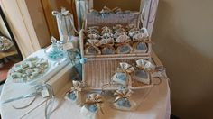 Everyone will love this favours station: off white and powdery blue for young boys baptism