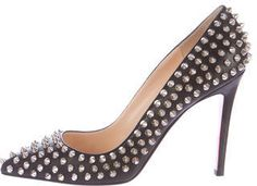 Black leather Christian Louboutin Pigalle Spikes 100 pumps with pointed toes, silver-tone spike embellishment throughout and covered heels. Includes box and dust bag.