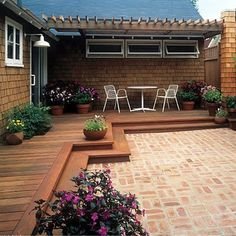 Deck meets brick patio; pergola roof