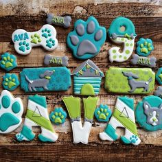 Dog cookies~                                   Unknown source, white bones, turquoise pet paws, neon green, dog house, initial, number,