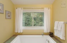 We installed a new sliding window over the bathtub in this stunning master bathroom . Remodeling / Renovation / Home Improvement / Replacement window from Renewal by Andersen Long Island Home, Master Bathroom, Windows, Home Improvement, Remodeling Renovation, Remodel, Andersen Replacement Windows, Renovations, Slider Window