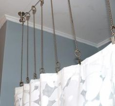 solution for low shower curtain bar and high ceilings in our bathroom. ceiling mounted shower bar!