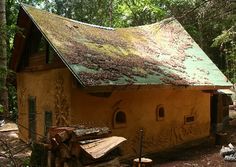 Straw Bale house on Mayne Island with first stages of a living roof, photo by Monica Holy for 'Middle Earth Home'