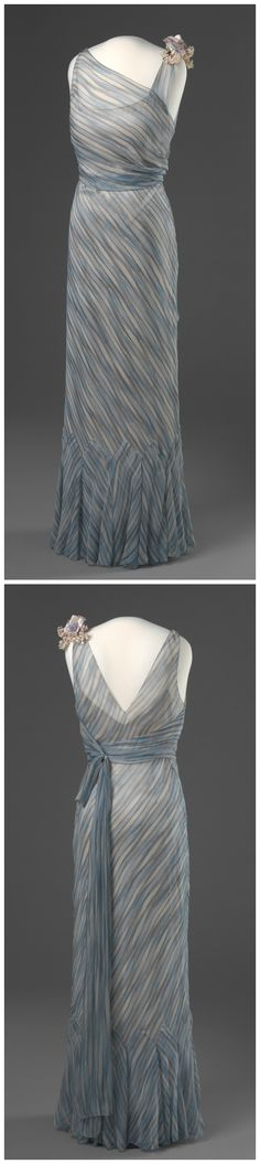 """Evening dress belonging to Queen Maud of Norway, possibly by W. W. Reville-Terry Ltd., London, c. 1935. The National Museum of Art, Architecture and Design, Oslo, via DigitaltMuseum (link: http://digitaltmuseum.no/011062311979?pos=46&count=133&folder_id=2144). According to the book """"Style & Splendour: The Wardrobe of Queen Maud of Norway, 1896-1938,"""" this may have been the blue and silver-grey striped chiffon gown that Queen Maud is said to have worn on Midsummer's Eve 1935."""