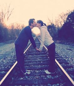 Couple picture on a railroad!
