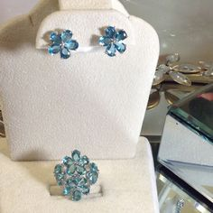 Stunning Blue Topaz Ring / Earring Set This gorgeous Multi-stone Fine colored topaz ring is set in Sterling Silver marked 925. This ring is a match to the topaz flower earrings also posted in my closet. These two pieces are one of a kind unto themselves. They happen to be two of my personal favorite pieces. I will sell only for firm listed individual price! Thank you for visiting my closet! Artisan Crafted Jewelry Rings