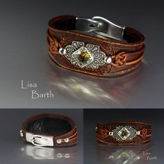 Here is a green garnet I set in fine silver.  I tooled the leather and dyed it a redish brown, then sanded part of that off.   I also burnished the sides so it looks like it has been worn for years.   I like things that look old.  I lined the inside with sheepskin so it is really soft to wear. --Lisa Barth