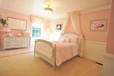 Little girls bedroom with bed canopy curtain