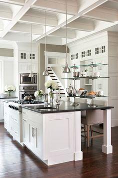 kitchen with khaki walls paint color, white kitchen cabinets, black granite