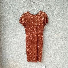 b837bc85ed8 Vintage beaded dress in burnt umber copper color. Mostly cotton with  elastic. The