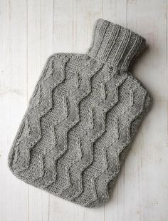 Knit hot water bottle cover.