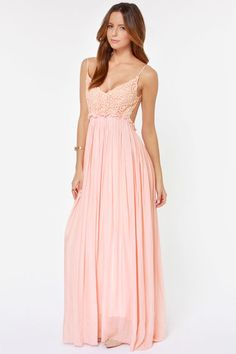 """Picture yourself walking through a flourishing meadow during Spring in the elegant Blooming Prairie Crocheted Pink Maxi Dress! A triangle bodice is packed with elegant Boho appeal thanks to a floral crochet overlay, while spaghetti straps frame an alluring open back. A maxi-length skirt flows gracefully from a gathered and unfinished waistline with hidden elastic, all the way to a dreamy unfinished hem. Lined. Model is 5'11"""" and is wearing a size small. Self: 100% Cotton. Polyester l..."""