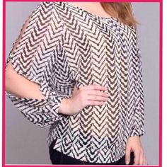 Black/White Top Plus size top  , long sleeve with two slits down the sleeve , on the back details with black on the bottom hem.. Material 65% cotton an 35% polyester .. Umgee Tops Blouses