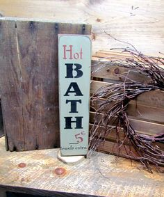 """This wooden sign is made from pine, and measures 14"""" H x 3.5 It reads """"Hot Baths 5 cents"""". Great for any bathroom. It is painted sage green then distressed, stained and sealed to last for years. All o"""