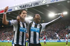 Wijnaldum (right) is joined by team-mate Daryl Janmaat as both celebrate in front of the home fans after going two goals ahead
