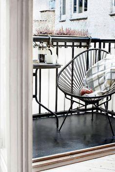 acapulco chair on balcony