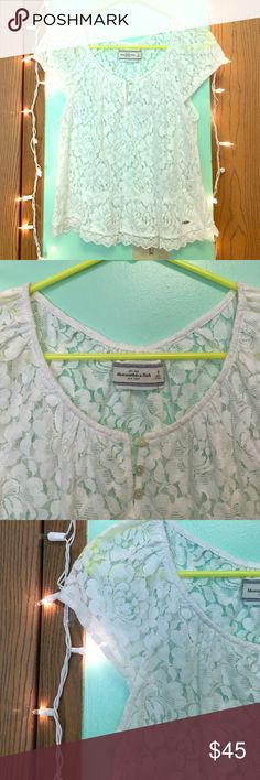 🎀 Lacey Abercrombie & Fitch Top 🎀 Brand new, never worn! 💖 Gorgeous white laced top. It has short sleeves. 🙂 Cute 3 button up around neckline. It is all around lace, so all around see thru! Would look super cute with a bandeau bra. 💖 (ALSO-- the 2nd button down. The thread came undone on the one side, so it just needs to be sewn back. Even with it undone, you can't really tell.) NO RIPS, TEARS, or STAINS! 😊 Abercrombie & Fitch Tops Blouses