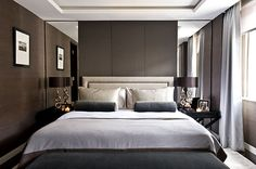 tall mirrors either side of high headboard contemporary bedroom Peek Architecture Lowndes Square