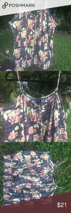 Torrid 4 curvy girl perfect summer tank Perfectly comfy and cute summer tank with adjustable neckline ( depends on how tight you pull the string which ties at the front- you can scrunch the fabric to your liking) pink and yellow floral on gray background. Gathered elastic at waistline. Great condition from smoke free home. torrid Tops Tank Tops