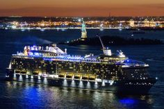 Quantum of the Seas waves to Lady Liberty.