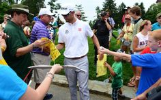 Adam Scott signs autographs for fans as he plays in the pro-am.