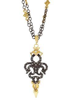 Black on black - Always a good choice. Old World midnight and 18K yellow-gold black diamond Fleur de Lis blade enhancer on doubled white diamond cravelli chain.    Image property of Armenta.