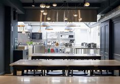 The Cookery School, fluid transition between spaces. View of the kitchen.