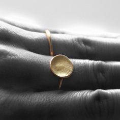 fingerprint ring...you could use your kids or your husbands fingerprint.