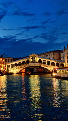Venice, Rialto Bridge.  canal, gondola, boat, night, lights, houses, clouds, Italy