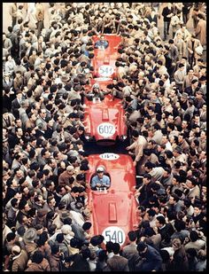 Lancia entered four D24 cars for the 1954 Mille Miglia. F1 world champion Alberto Ascari drove his Lancia to victory at the legendary event, and the team was swarmed by fans at the finish.