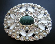 BEAUTIFUL WHITE RHINESTONE FLOWER FLORAL WITH A GREEN STONE DRESSY BELT BUCKLE!