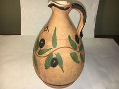 A personal favorite from my Etsy shop https://www.etsy.com/listing/496095724/jug-retro-raw-brown-jug-green-leaf