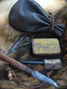 Small tinder/fire kit I put togther by Howling Dingo, via Flickr