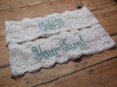 This is a garter set. One to toss on your special day and one to keep and remember the day. The keepsake garter has your new wedding initials