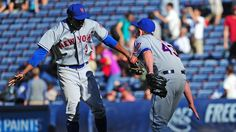 The Mets erase a 7-4 deficit with a three-run homer from Daniel Murphy and defeat the Braves in 10 innings 10-7.