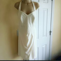 "Ivory white Dress. Absolutely stunning. Neck holder tie dress with visible zipper in the back. Lace detail in the front  and back.as seen on photos. Size M  (8-10).  Approx. 34"" long and 17""wide. The back has some stretch to it. 90%Rayon  10 Nylon. Lined. New with tags.   No trades. Considering reasonable offers. Etcetera Dresses Wedding"