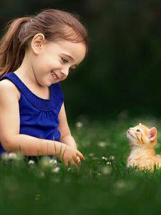 Sweet little girl and her kitten
