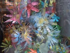 This was one of the most beautiful store displays that I have ever seen...recycled bottle flowers....anthropologie!!