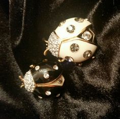 Joan Rivers Ladybugs Brooches Set/2 Darling ladybugs made in her classic style.  Black and white enamel and crystals on gold-tone base.  Both brooches are stamped on back.  Joan loved her insects!  These are retired and collectible pieces from her collection.   No Trades or PP   Please use Offer Button Joan Rivers  Jewelry Brooches